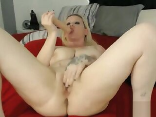 Big tits blonde MILF toys her pussy
