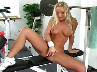 Milf rubs pussy at the gym in a XXX solo