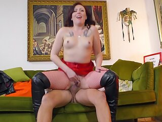 Redhead slut respecting fishnet stockings gets fucked hard hard by an patriarch dude