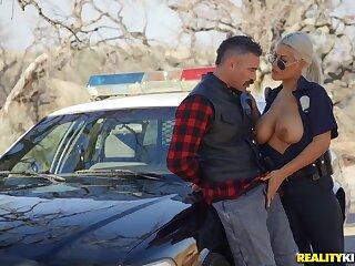 Busty female cop treats herself beside a big dick