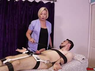 Strict comme �a masseuse gives a Femdom handjob to a bound buyer