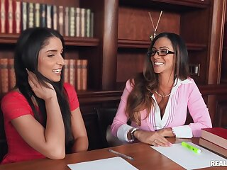 Lewd library antics with babes Giselle Leon and Ariella Ferrera